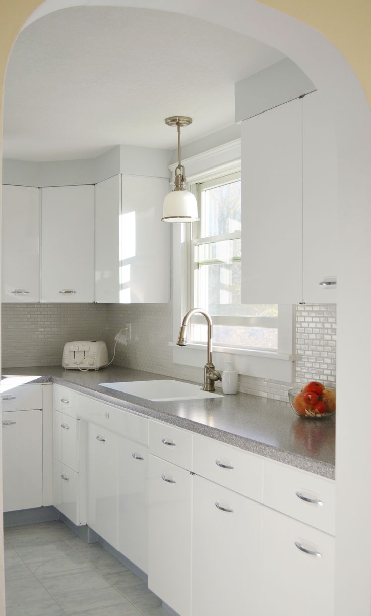best 25 midcentury kitchen faucets ideas on pinterest hackel construction inc remodeled this 1950 s kitchen by having the geneva brand metal cabinets