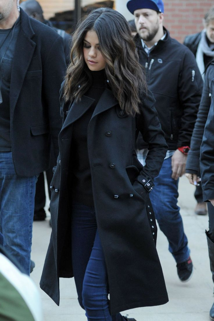 Selena Gomez winter street style with black coat.