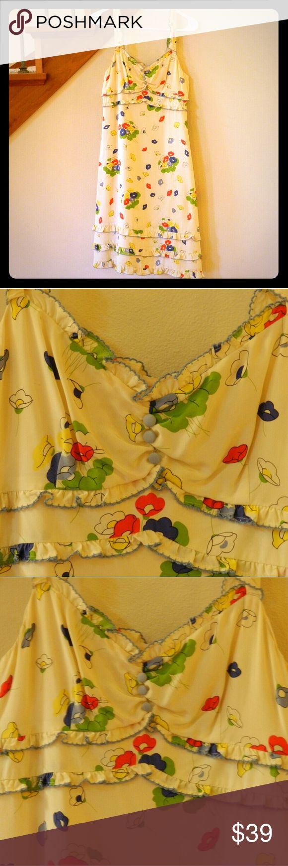 """Vintage floral silk dress Vintage Odille dress for Anthropologie. ?Beautiful and charming styling is so eye catching in cream silk with red, yellow, and blue flower patches. ?Edges are trimmed with ruffles with delicate blue embroidery. ?Bodice decorated with a row of blue fabric covered buttons. ?Side zip. ?100% silk; 100% acetate lining. ?Size 4, slim fitting, approximate measurements: ?40""""L, 14""""W, 17""""B. Anthropologie  Dresses Midi"""