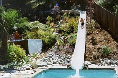 Hillside pool slide faux rock painting pinterest for Hillside pool ideas