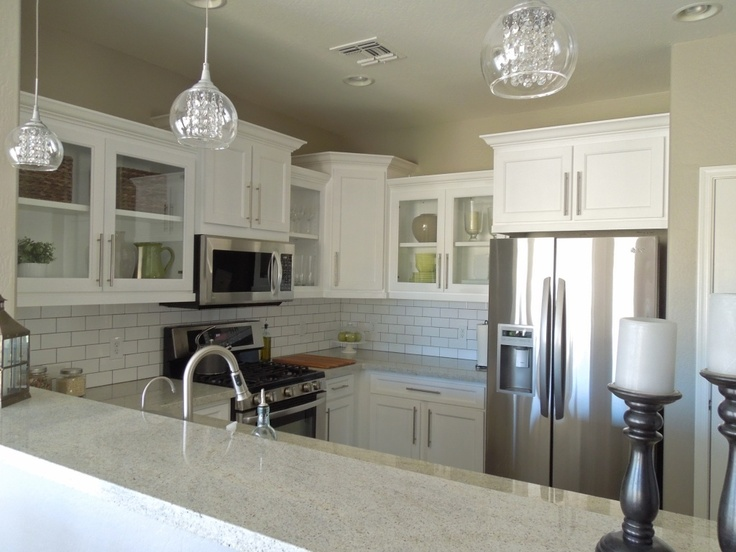 8' x 13' small kitchen, beautiful! Granite color is Kashmir White  Cabinets: Appliances are all LG;  Faucet is from home depot;Cabinet hardware is from Lowe's  Lighting is from Lamps Plus