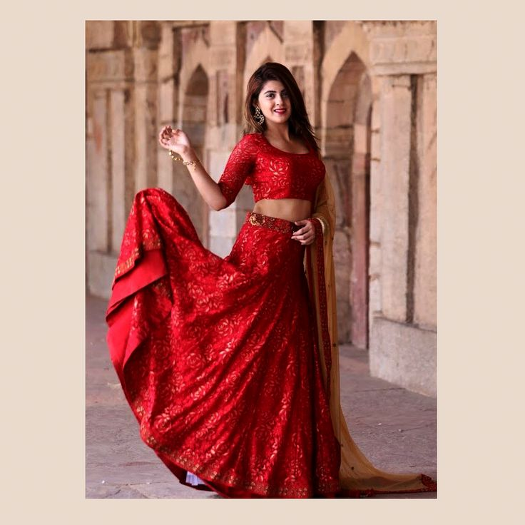 A traditional bridal lace lehenga is updated using lace and a clever weave of sequins within in.