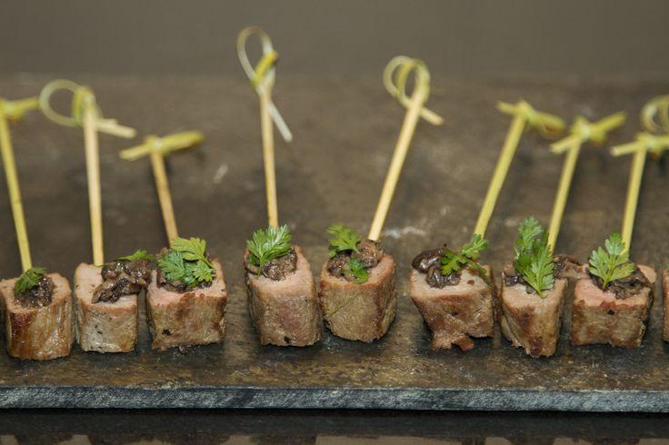 Grilled beef skewers with truffled mushrooms