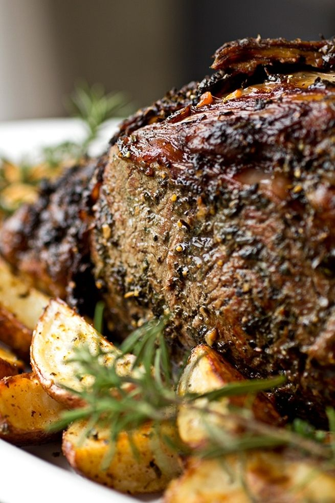 Herb Crusted, Garlic-Stuffed Prime Rib Roast with Creamy Dijon-Horseradish Sauce and Au Jus