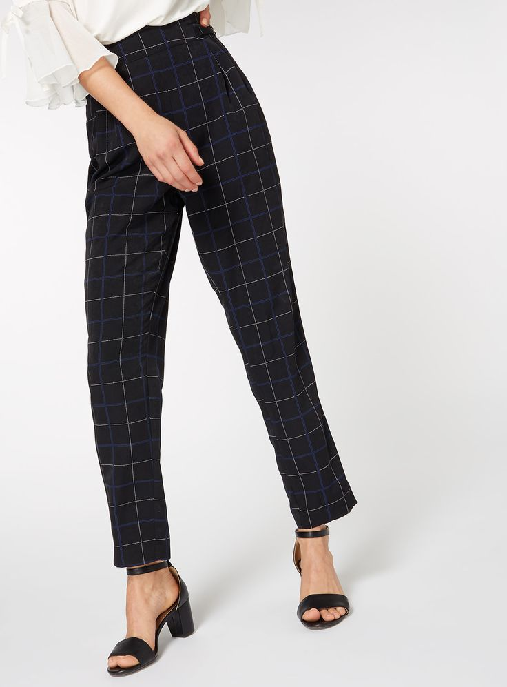Freshen up your formal wardrobe with these chic tartan style trousers. Featuring pleats and a tapered leg fit, these trousers are perfect for both professional and casual looks. Couple with a glamorous black blouse for a complete look.   MultiColoured check trouser Check print Tapered fit Left side buckle fastening Size zip Model's height is 5'11'' Model wears a size 12