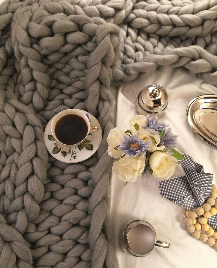 Coffee on the bed with cozy merino blanket