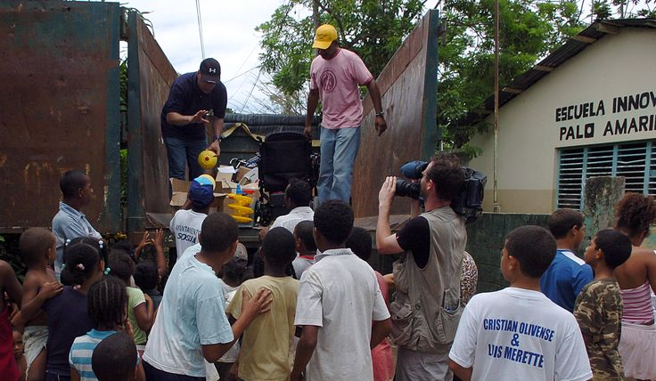 Filming aid from Canada arriving at the poverty-stricken community of Palo Amarillo near Sosua in the Dominican Republic. #photojournalism #documentary #travel #poverty #realworldphotographs #sony #children #dominicanrepublic