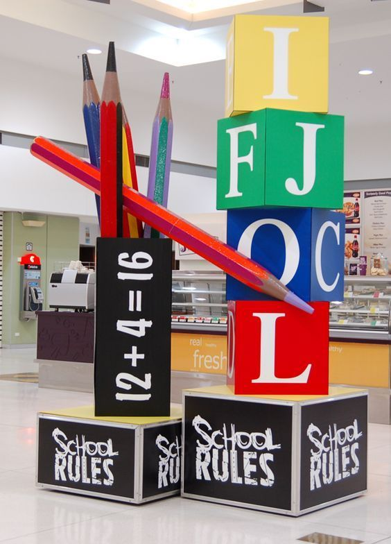 Back-to-school window display? Possibly with blocks like these but with clothes pinned to them or backpacks?