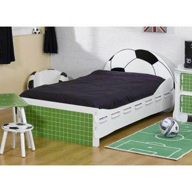 A cool football bed with a football shape headboard and a goalmouth shaped footboard.