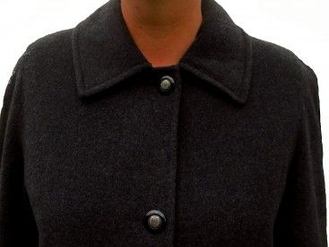 A long European winter wool coat with a full lining in a straight cut, wide lapels, two pockets, exceptional quality and very comfortable. In immacualte condition.