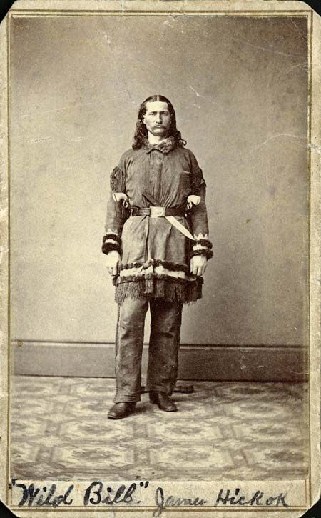 """James Butler Hickok (1837-1876), better known as """"Wild Bill"""" Hickok, was a skilled gunfighter, gambler, and lawman.  Hickok went west at age 18, first working as a stagecoach driver, then as a lawman in the frontier territories of Kansas and Nebraska. He fought (and spied) for the Union Army during the American Civil War. After the war he was a scout, marksman, actor, and professional gambler. He was involved in several notable shootouts before being killed while gambling."""