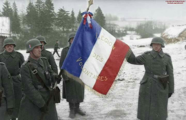 French soldiers of the German Legion des Voluntaires unit holding a French flag in Russia, 1941.   https://facebook.com/colorsww2