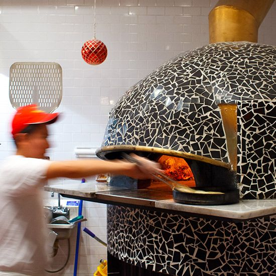 """FORCELLA Known for his specialty, flash-fried then oven-fired pizzas crusts, Forcella chef-owner Giulio Adriani uses Neapolitan Acunto ovens. He decorated them himself with hand-cracked black tiles. Oven maker Mario Acunto sells his ovens at whatever price he feels is right for the buyer. """"He doesn't care about selling the oven,"""" Adriani says. """"In Napoli they call him Mario matto—Mario the crazy guy."""" Must try: The Montanara, a Margherita with a fried crust that's finished in the oven"""