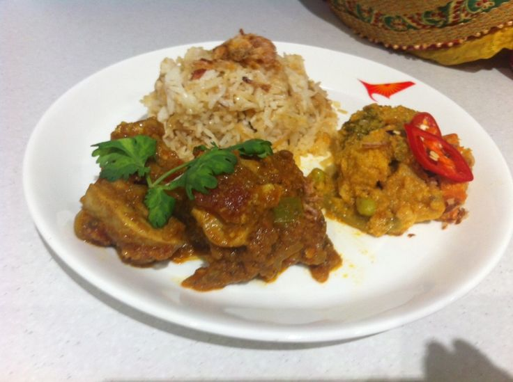 Air India Business class Menu - Indian style chicken served with fragrant onion pilaf