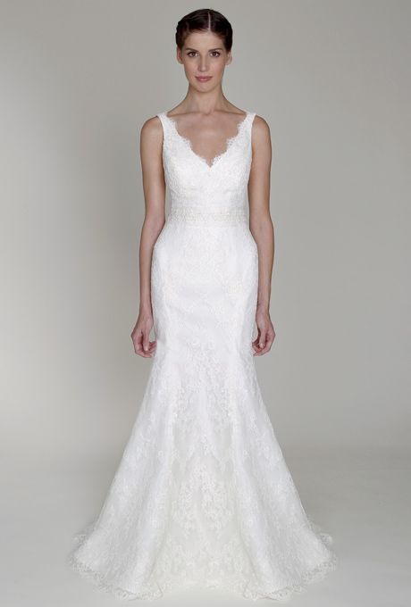 Brides: Bliss by Monique Lhuillier. Ivory re-embroidered lace V-neck sheath with trumpet skirt.