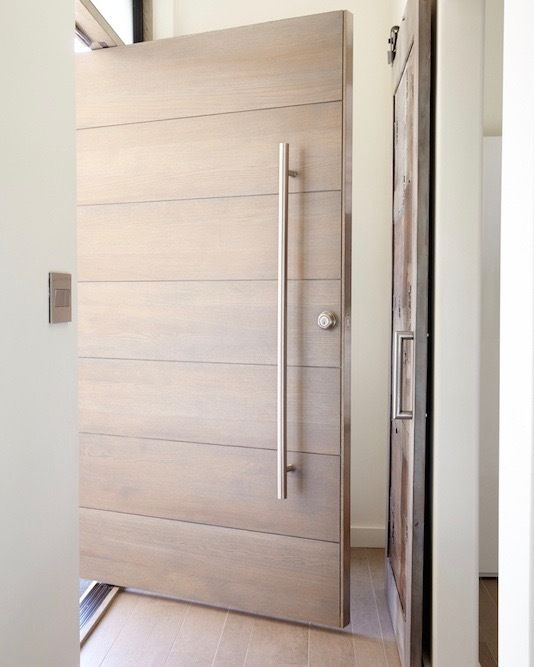 Natural wood doors are IN! Bring a touch of the outdoors to your entryway by designing a pivot door at http://www.pivotdoorcompany.com/Exterior-Doors/.