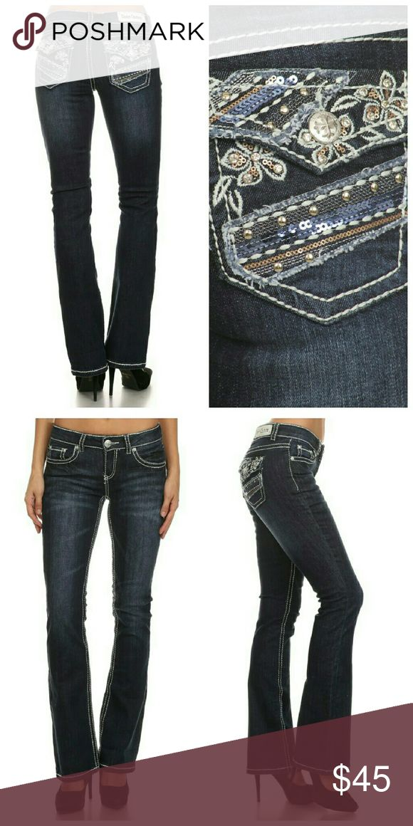 """Flirty Floral Embellished Boot cut Jeans 96% Cotton 4% Spandex   Boot cut Jeans, machine washable. Zipper and button closure, belt loops. Rhinestones and studs on the back pockets. Medium wash with whispering and fading at tights and seat.   Sizes are 1, 3, 5, 7, 9, 11, 13, 15  Inseam is 32"""" Jeans Boot Cut"""