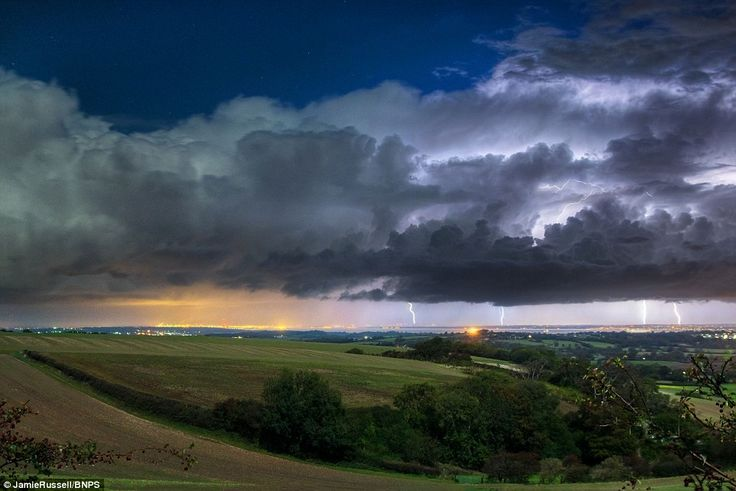 Dramatic: Lightning strikes in the distance as storms gather at Brading Down, looking nort...