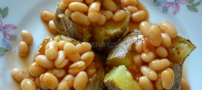 Baked Potatoes topped with baked beans and cheese
