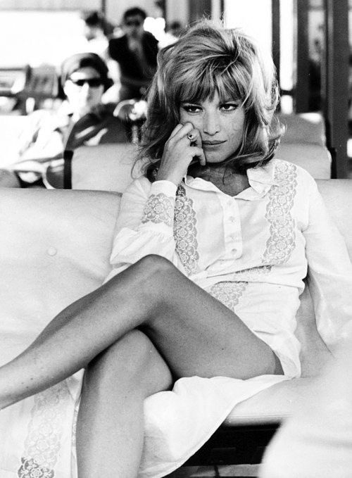 Monica Vitti. If you don't fall in love with her strangely attractive charm, you will ultimately be seduced by her shiver-inducing voice. All of you, ladies & gents!