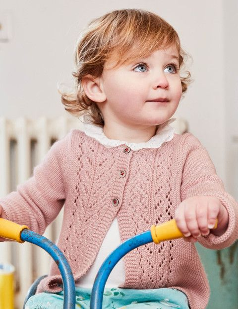 This cardigan is made using a touch of cashmere for the softest of cuddles with your baby. It handles spills with ease – just pop it in the machine. The pretty colours with contrast stitching and buttons are perfect for layering over dresses, as well as teaming with the rest of the range.