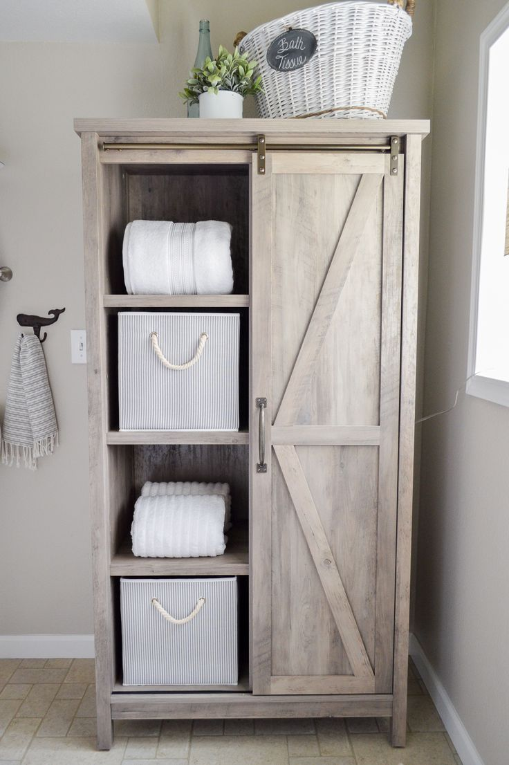 This girl made over her whole bathroom with things from Better Homes & Gardens at Walmart. I love this furniture piece. Can you believe she got this Farmhouse barn door storage cabinet there!? sponsored pin
