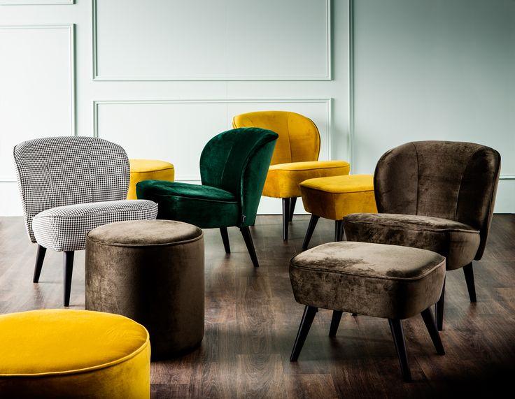 Comfortabele fauteuils zorgen voor dat instant hotel lobby-effect.