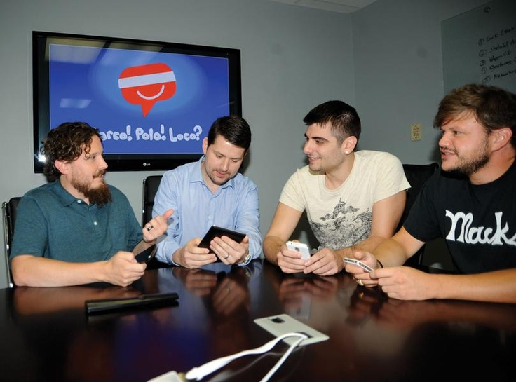 @Laura Bonazza Joe Roets (left), president and CEO of MarcoPoloLoco LLC; Alexi Leontopoulos, project manager; Jon Bonazza, Android software developer; and Ricky Hussman, iPhone software developer, demonstrate the MarcoPoloLoco social media app Tuesday at their office in White Hall. This mobile app focuses on sending messages using location and time, while also protecting the user's privacy.