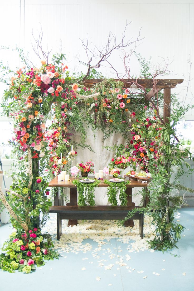 Gorgeous modern garden style chuppah with bright flowers // Hoot & Holler