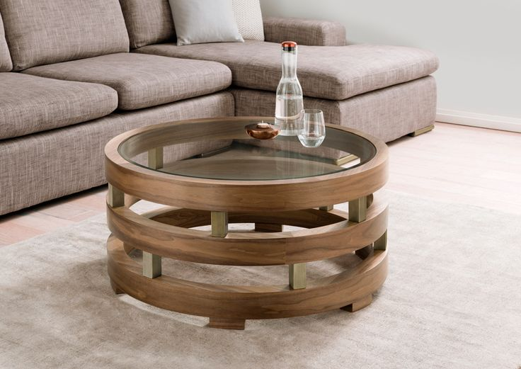Replay: walnut rings, supported with brushed bronze sections, and a finish with a bevelled edge glass top