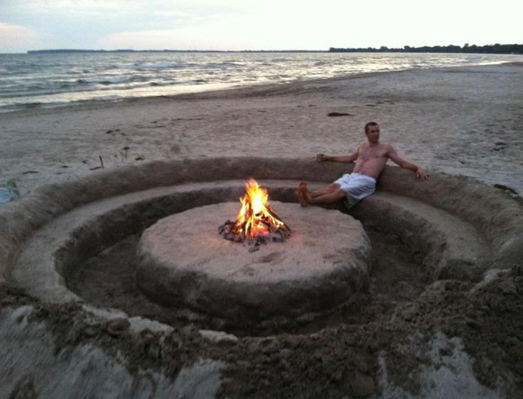 Get a group to help and create this amazing sand sitting circle with firepit for your next beach party!