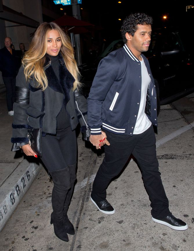 Expectant mom Ciara holds hands with husband Russell Wilson in West Hollywood.