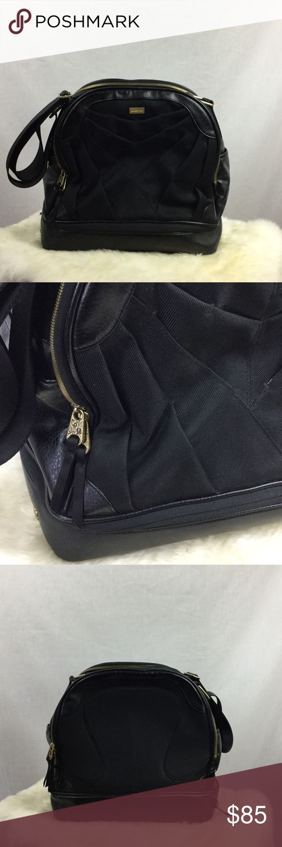"""Lululemon Activa Bowling Bag Bottom unzips for shoe storage.  Some dust from storing.  One small nick and tiny wear on trim as seen in photos. Makeup area inside has pen stain. Tons of storage!  Some scuffs on bottom and scratches on gold hardware. Inside is very clean.  Adjustable thick 2"""" strap. Approx 14"""" wide, 14"""" high, and 8"""" deep. lululemon athletica Bags"""