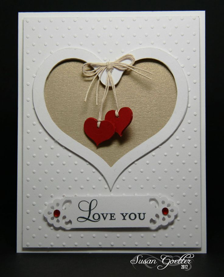 I like the idea of dangly bits in a cut-out which has a solid backing, as opposed to seeing them when the card is opened also.