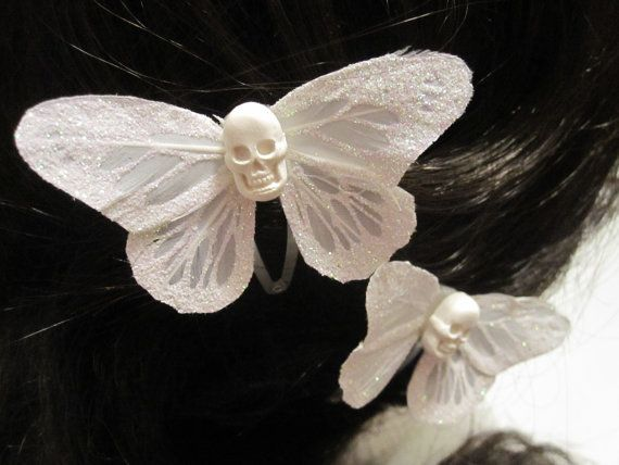 Hey, I found this really awesome Etsy listing at http://www.etsy.com/listing/153338552/a-white-wedding-death-skull-butterfly