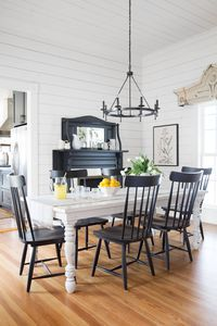 """""""Add+dimension+with+architectural+salvage.""""  - CountryLiving.com  White farmhouse table with black chairs and fireplace, very nice! #diningroom #diningroomtable"""