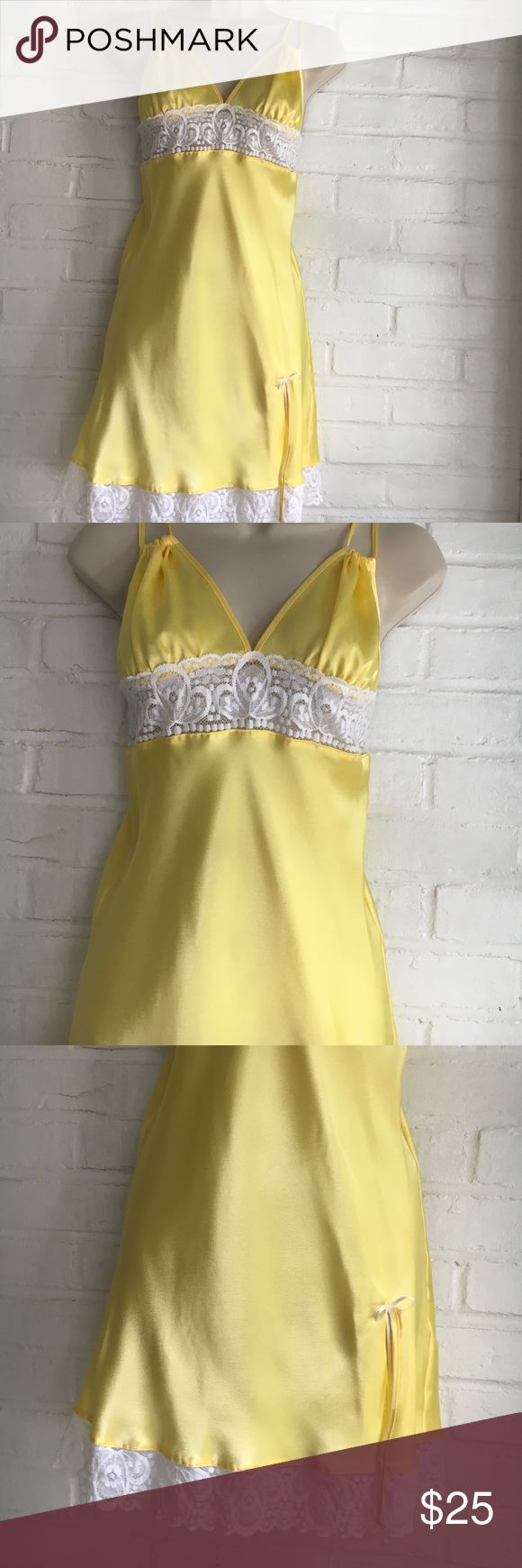 "Yellow Satin Nighty NWT Pretty yellow satin nighty trimmed with white lace at the empire waist and surrounding the bottom of nighty. With a sexy little split in the front, the material is 100% polyester. The sizes are as follows: SMALL-bust size lying flat approx 14"" and the length being 29"" long. LARGE-bust size lying flat approx 16"" and the length being 31"" Long. NWT Intimates & Sleepwear"