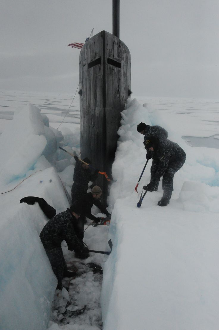 ARCTIC OCEAN (July 30, 2015) Sailors aboard the fast attack submarine USS Seawolf (SSN 21) remove arctic ice from the hull after surfacing at the North Pole. Seawolf conducted routine Arctic operations. (U.S. Navy photo/Released)