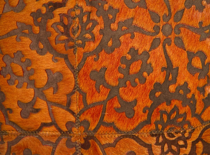 A close up pf the opulent textures of Art Hide's Zirah in orange. The Zirah is a beautiful, contemporary Asian-inspired floral motif design. For sizing, colour and purchasing information see the Art Hide website.