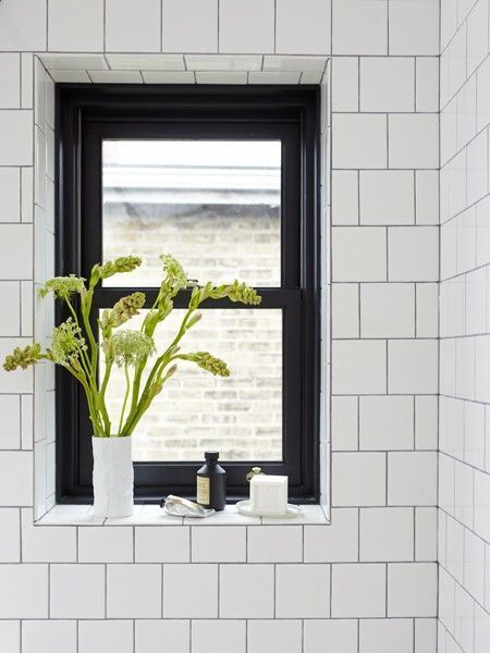 Bathroom Details: Simple Square White Tile Walls with Black Metal Window Frame