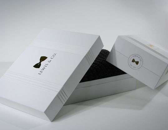 "Designed by Adrian Gilling | Country: United States    ""Lewis & Co. is a luxury mens clothing & accessories company, specializing in modern interpretations of classic aesthetics. I chose to reflect this sensibility in the packaging concepts through the use of tuxedo-shirt pleating and a minimalist palette."""