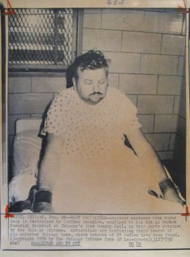 """CHICAGO, Dec. 28, 1978 """"GACY RESTRAINED"""" John Wayne Gacy is restrained by leather shackles, confined to his bed in Cermak Memorial Hospital at Chicago's Cook County jail. (Chicago Tribune)"""