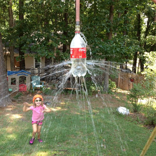 Take a 2 liter soda bottle, and poke holes in it. Hook your hose up to it, toss over a tree branch (we made our own since no good branches nearby) and turn on the water!""
