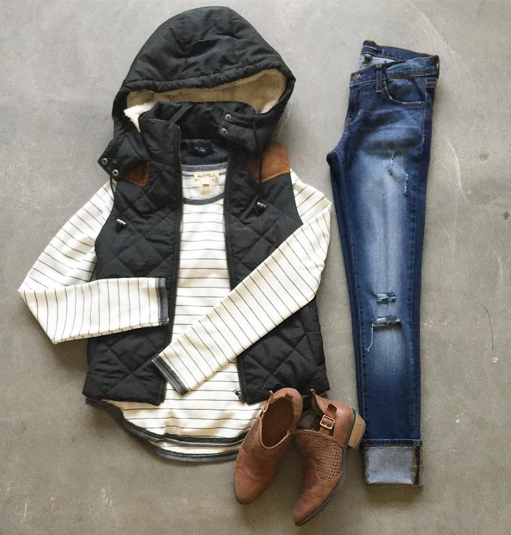 Stay warm and look cool doing it this fall in our adorable quilted forest green vest paired with a comfy striped sweater and some cognac booties!