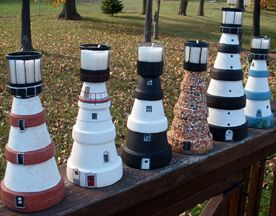 Clay Pot Lighthouse | ... lighthouses out of upside down, stacked flower pots, with candles on
