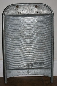 metal washboard, my mom used one of these to wash our cloths on...Marg