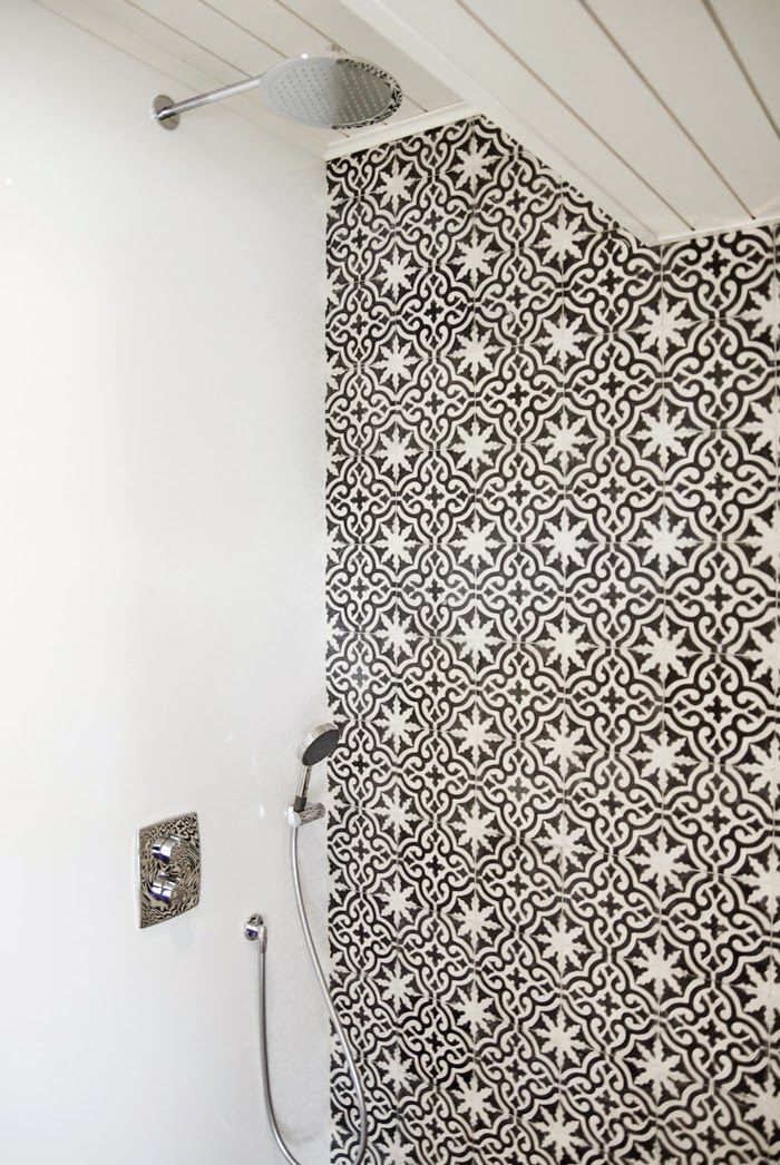 shower wall with moroccan tiles concrete wall, scandinavian interior, bathroom