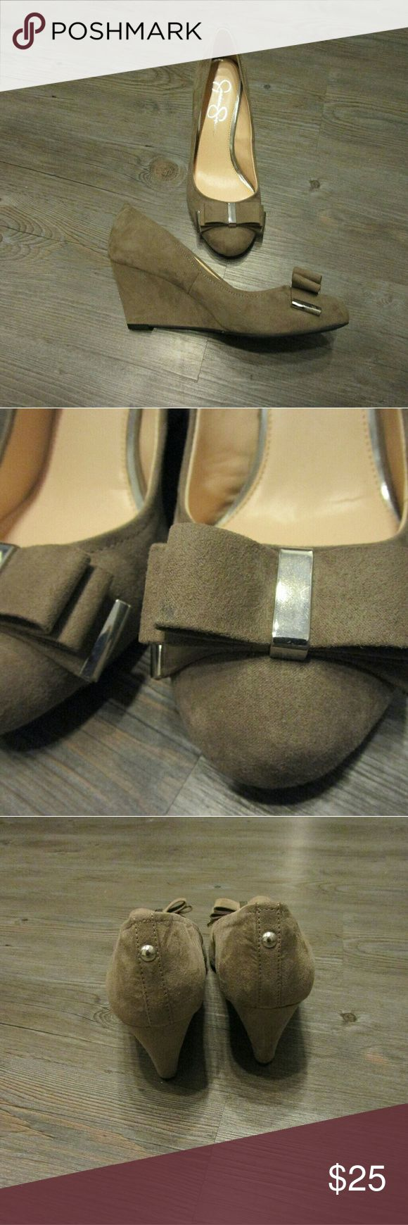 """Jessica Simpson Taupe Suede Wedges Heels Jessica Simpson suede wedge heels in like new condition with the exception of a small dark mark on the bow in the front (as shown in the second picture). No signs of wear otherwise. 3"""" heel height. Jessica Simpson Shoes Heels"""