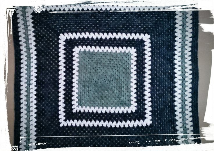 Stunning crochet baby blanket in teal,navy and white bamboo hand dyed yarn.