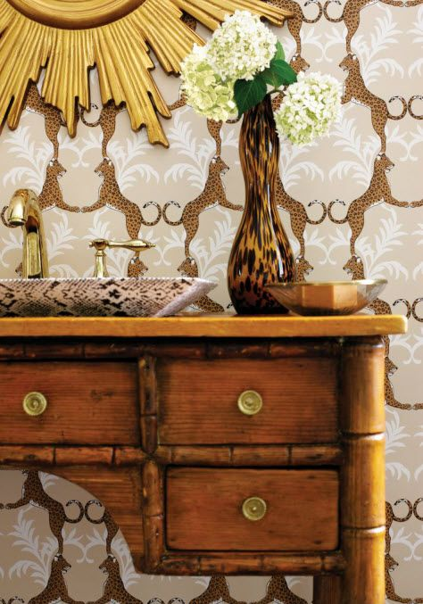 faux bamboo bathroom vanity with cheetah wallpaper from Thibaut.